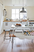 Bright eat-in kitchen in Scandinavian country house style in winter