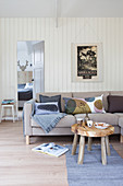 Winter living room in gray tones with a wooden wall