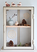 Showcase cabinet with winter decoration