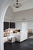 Living room in muted shades in converted church nave