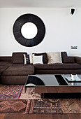 Coffee table with storage compartment in front of sofa in living room in shades of brown