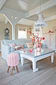 Rural living room in white, gray, and beige with romantic pink accents