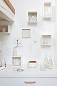 Small white wall shelves above the kitchenette