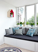 Millefleur pattern pillows on a day bed with drawers