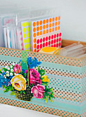Box with stickers covered with washi tape and poetic pictures