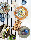Rural Easter table with cake, sugar eggs, and cookies