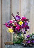 Summer bouquet of sweet peas, everlasting flowers, asters, goldenrod and spinach seeds