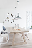 Light wooden table and bench in the Scandinavian style dining room