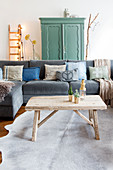 Rustic wooden coffee table in front of a gray sofa