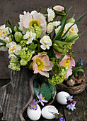 Easter bouquet with poppies, daffodils, snowball, and tulips with rustic decoration