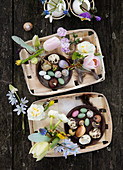 Baskets with spring flowers, Easter eggs, and natural finds