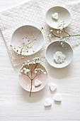 White bowls with gypsophila and hearts