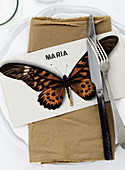 Card with butterfly motif and name as a place card
