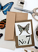 Greeting card with butterfly motif and number 7