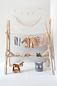 Rustic clothes rack made of branches without bark