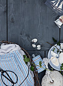 Maritime decoration, crafting material, and striped fabric on gray boards