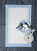 Homemade bath mat made from tea towels and striped fabric