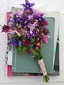 Different columbines in pink, violet and lilac as a bouquet