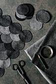 DIY cushion cover made of grey felt circles