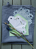 Paper snowflake, grape hyacinth, and pussy willow on an envelope