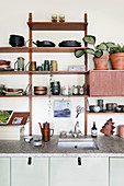 Wall shelf with dishes above the kitchenette