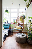 Hanging chair and footstool in the winter garden