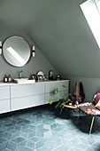 A long white vanity unit in an attic bathroom