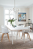White lacquered wooden table with shell chairs