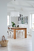 A solid wooden dining table with classic metal chairs
