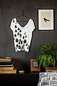 Self-printed T-shirt hung on a wall
