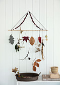 A DIY mobile made from autumnal objects