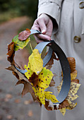 rounded paper structure with autumn leaves