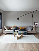 A light upholstered sofa and a coffee table on a natural white carpet