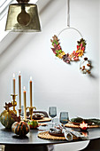 A table laid with autumn decorations