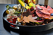Tray with autumn leaves