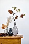 Autumnal arrangements in glass vases