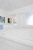 Built-in white bed in the small bedroom