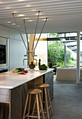 Bar stool at the kitchen island with fittings from the ceiling