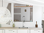 Kitchenette with sink in front of an opening to the living room