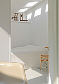 A view into a small bedroom all in white
