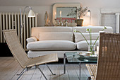 Wicker chairs and a beige sofa in a shabby chic living room