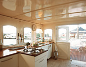Open kitchen and access to the terrace on a houseboat