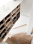 Shoe storage next to a winding staircase