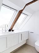 Built-in vanity unit under the skylights