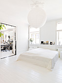 Plain bed in the bedroom with a white floor