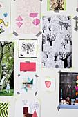 Collage mit Masking Tape an die Wand geklebt