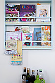 Wall-mounted book rack with cookbooks
