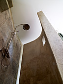 Shower area with concrete wall