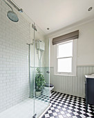 Classic bathroom with chequered floor, wainscoting and tiled shower area