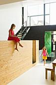 Girls in open-plan interior of modern building